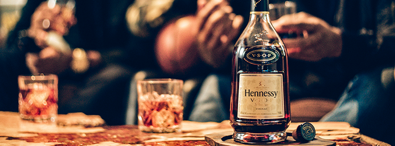 Bottle of Hennessy with two glasses