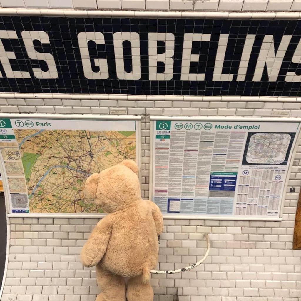Giant teddy bear in the Paris Metro