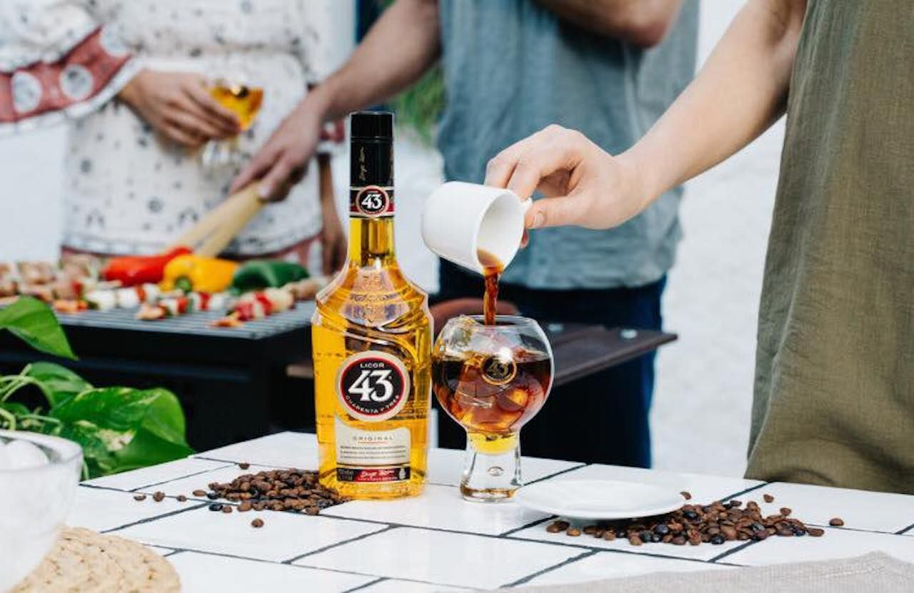 People drinking Licor 43, a digestif from Mexico
