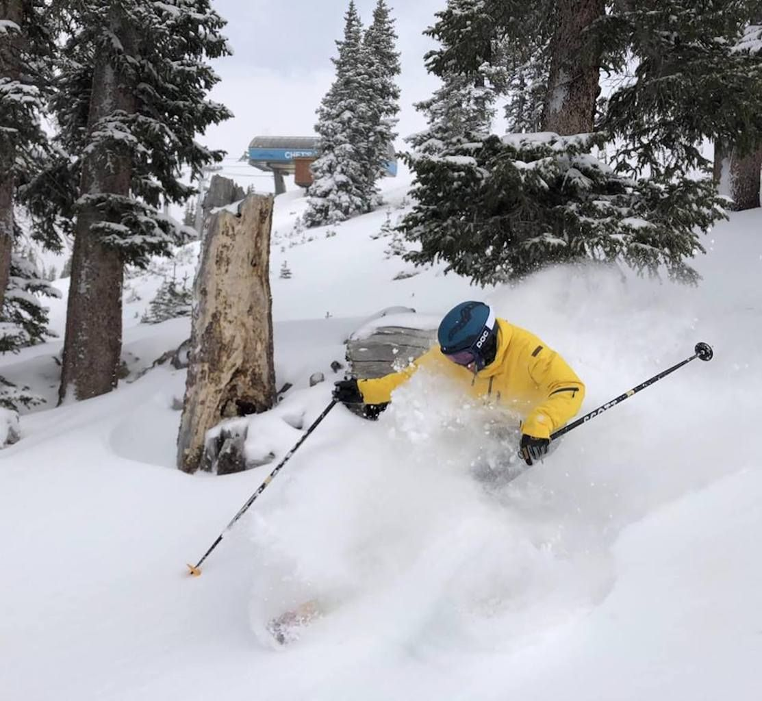Skier shredding through fresh powder
