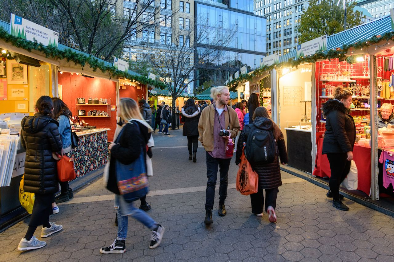 People strolling and shopping the Union Square Holiday Market in New York City
