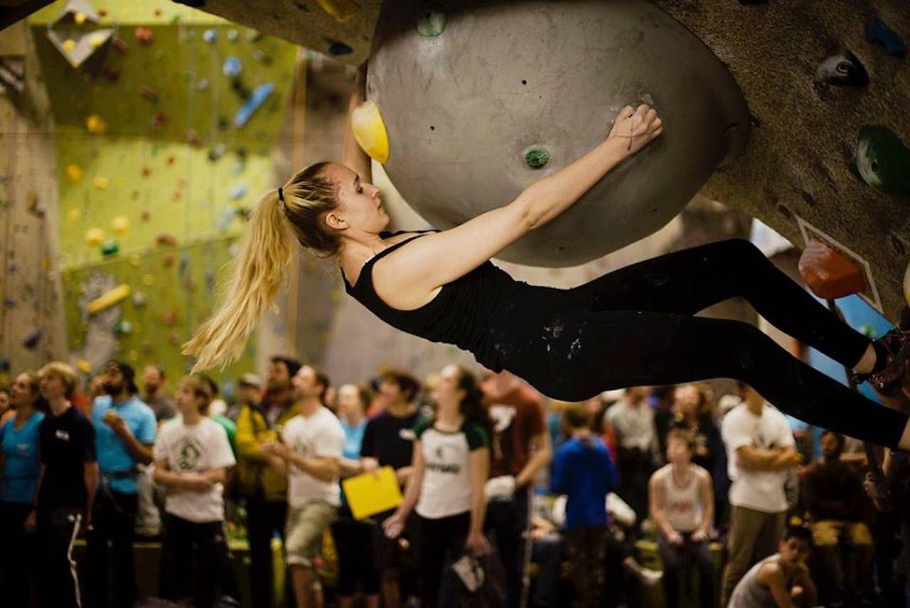 Rock climber on a wall at a climbing gym