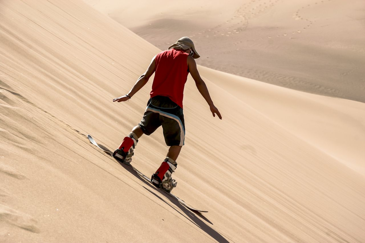 Sandboarding in the Dessert of the Atacama, San Pedro de Atacama, Chile