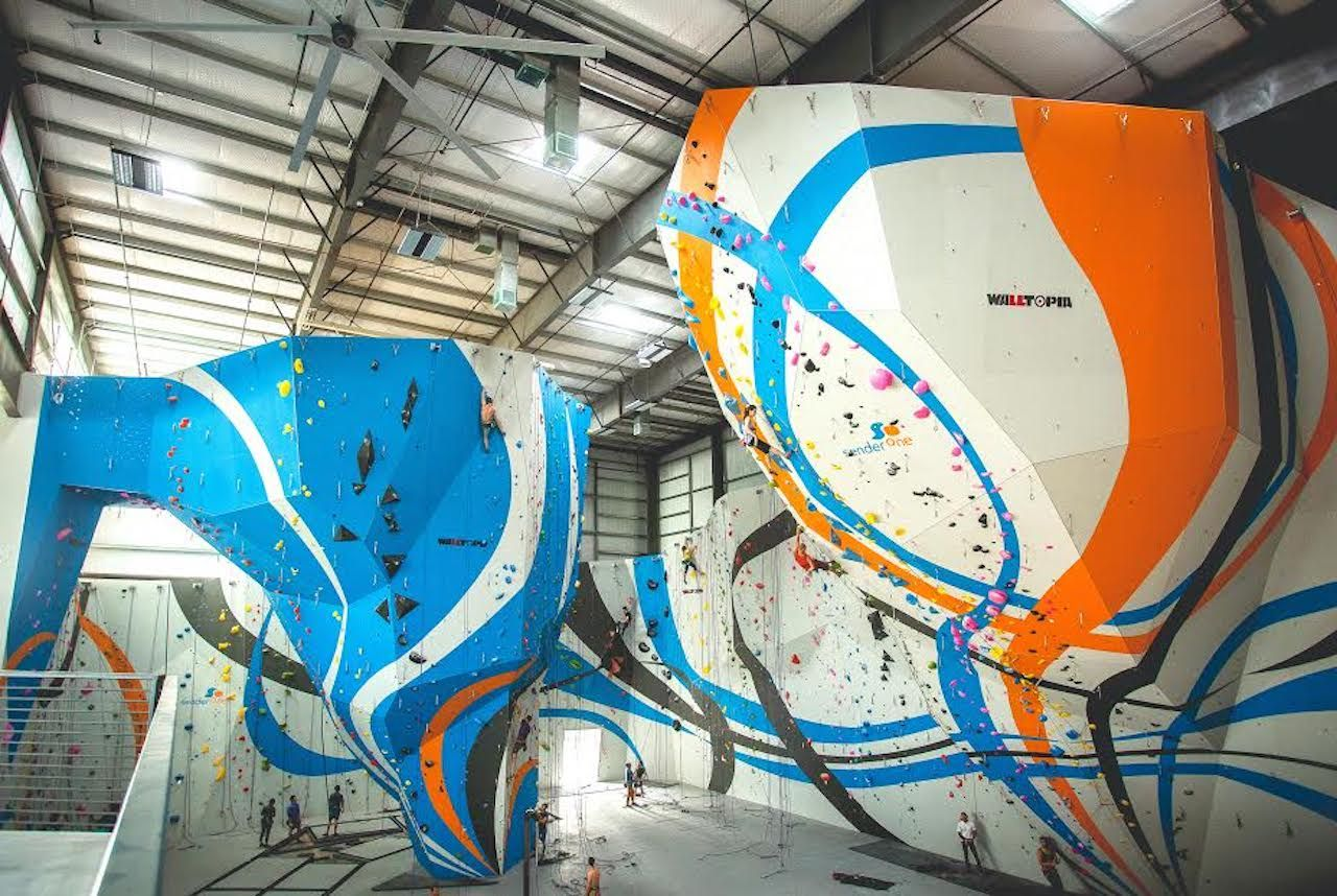 Colorful rock walls in a rock climbing gym