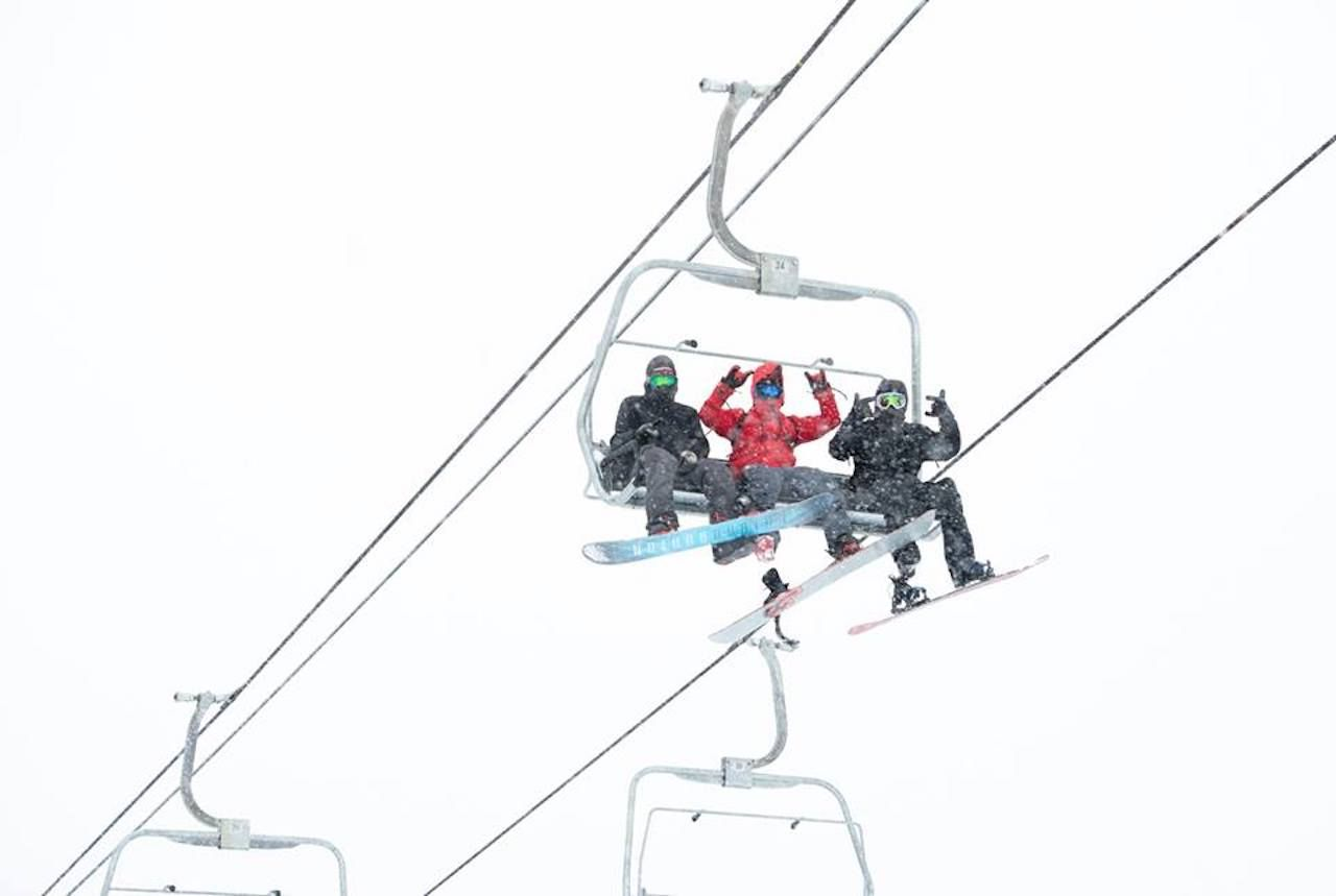 Skiers on a chairlift at Soda Springs Ski Resort