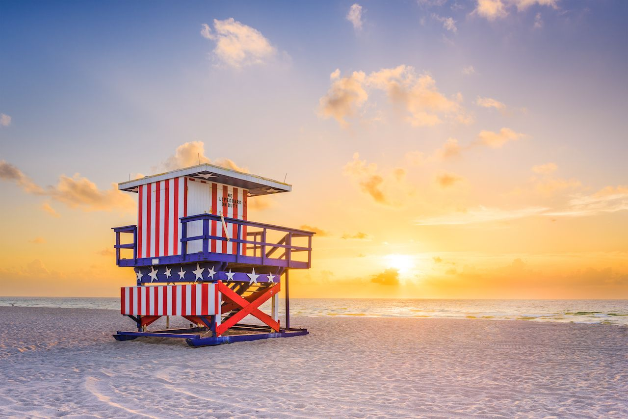 Sunrise and lifeguard tower in Miami Beach, Florida