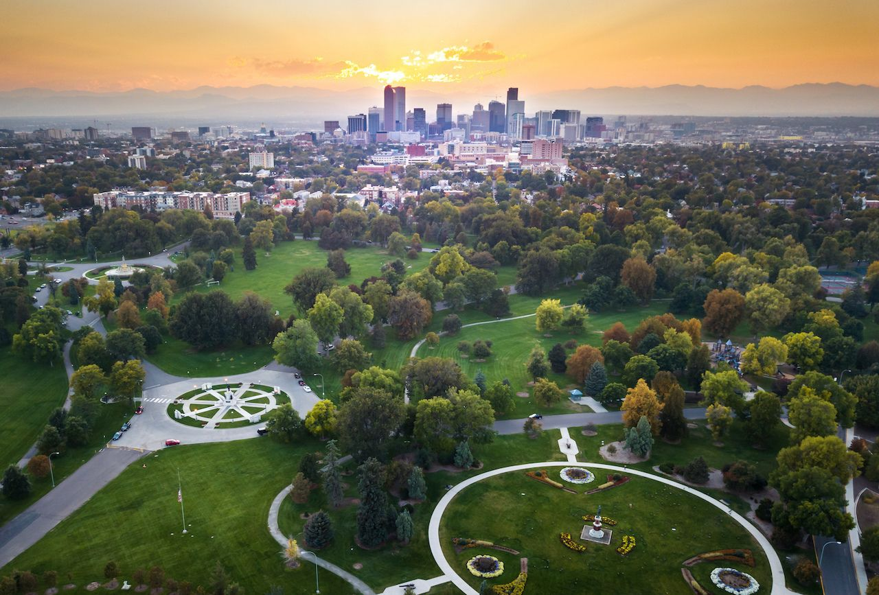 Sunset over Denver cityscape with green parks