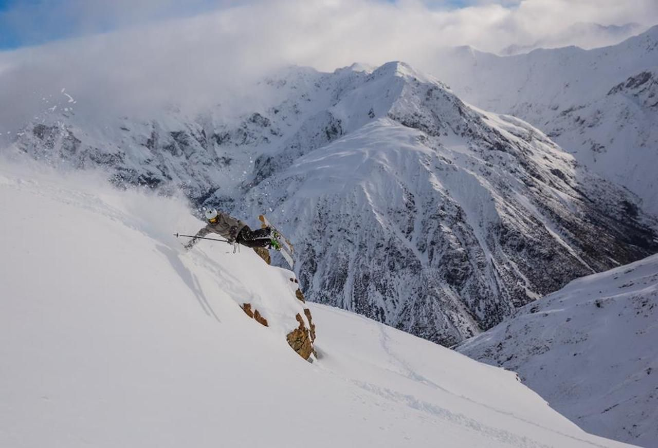 Skier doing jumps on the mountain at Temple Basin