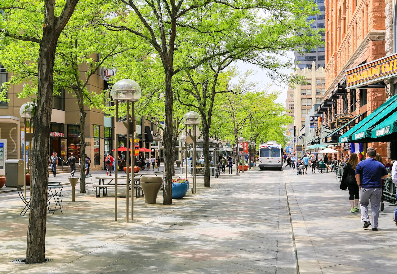 The 16th street mall in downtown Denver with shops and cafes