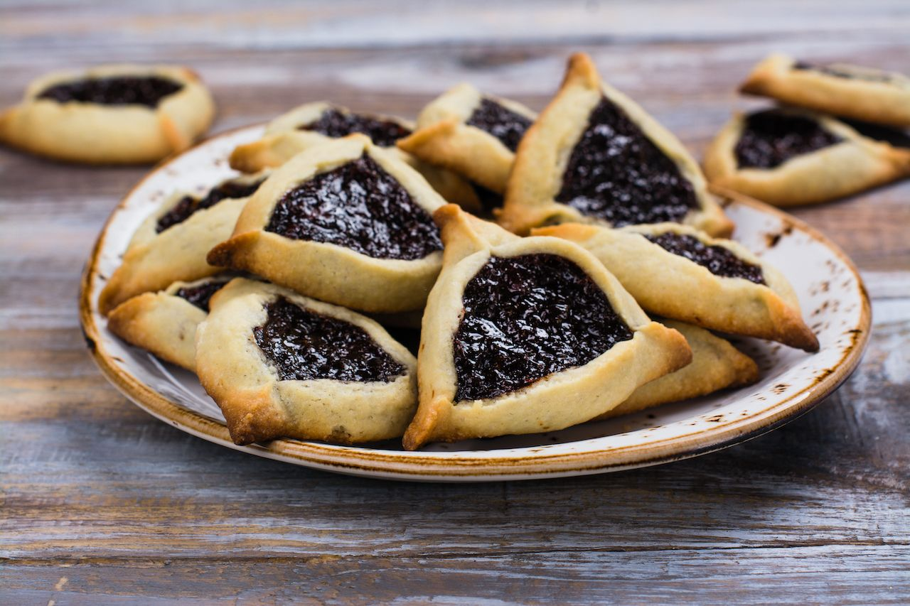 Traditional Jewish Hamantaschen cookies with berry jam