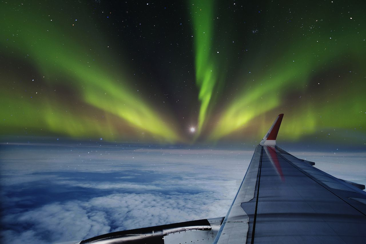 See northern lights from a jet