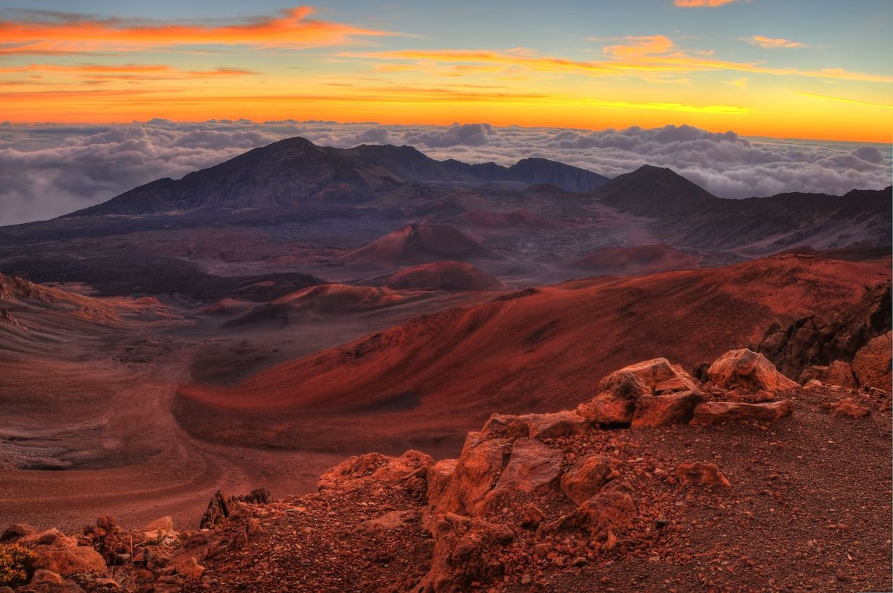Volcanic crater landscape with beautiful orange clouds at sunrise at Haleakala National Park in Maui, Hawaii