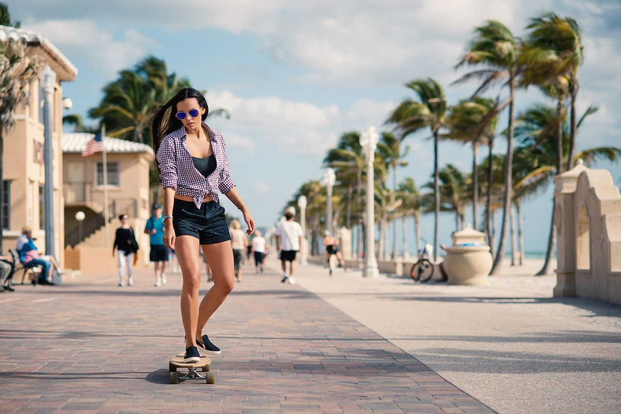 Woman on a skateboard at Hollywood Beach in Miami, Florida