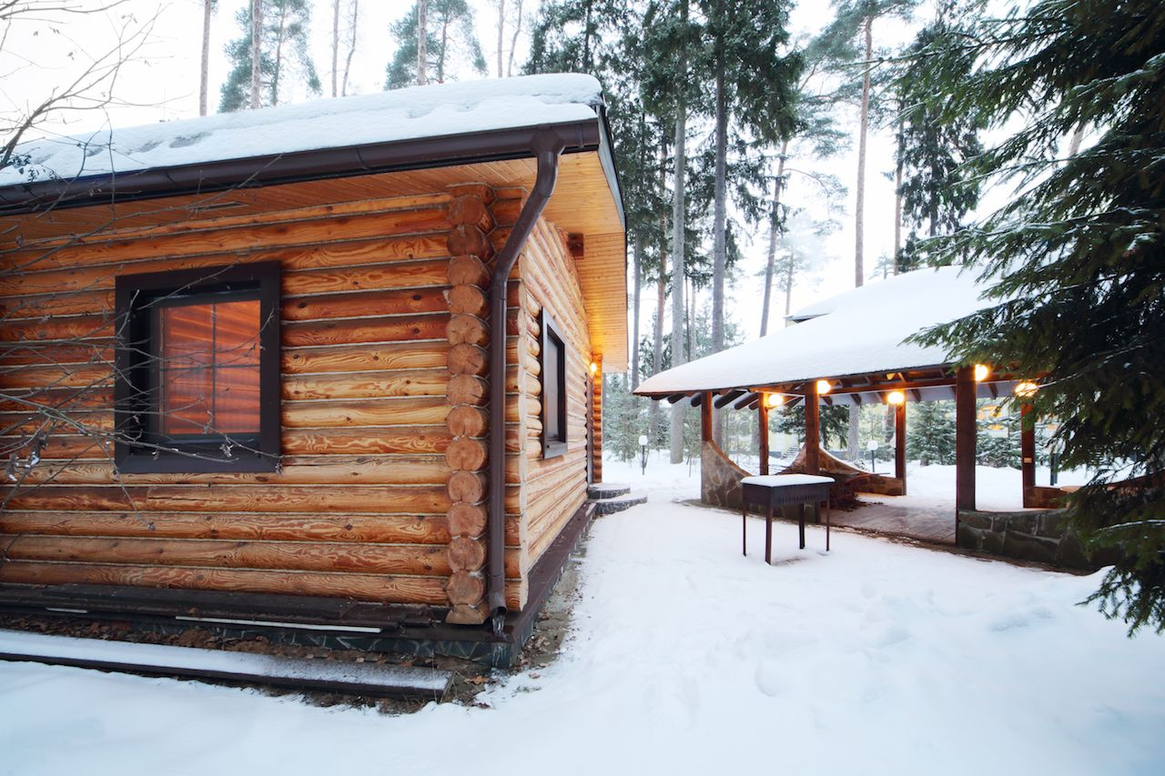 Wooden sauna house in the snowy woods
