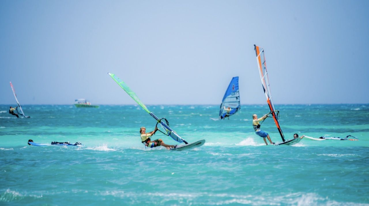 windsurfers in turqoise water in Aruba