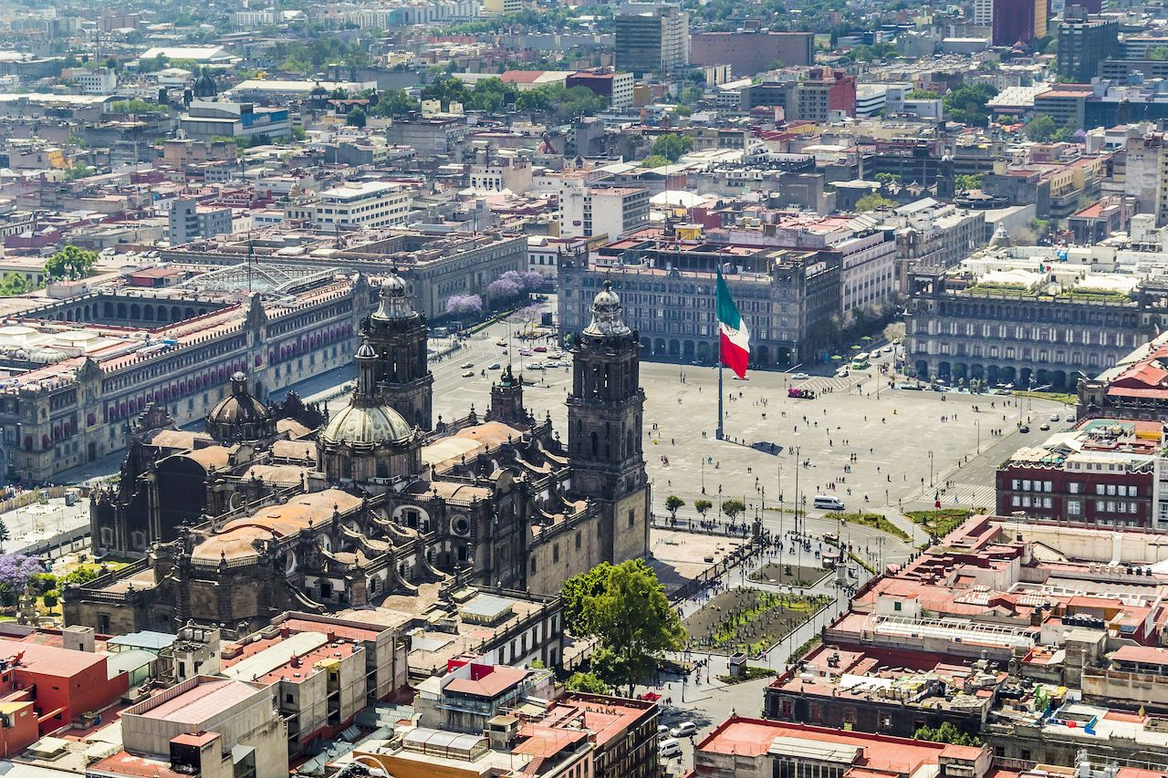 Aerial view of Mexico City with pedestal, flag and most important buildings of Mexico's government