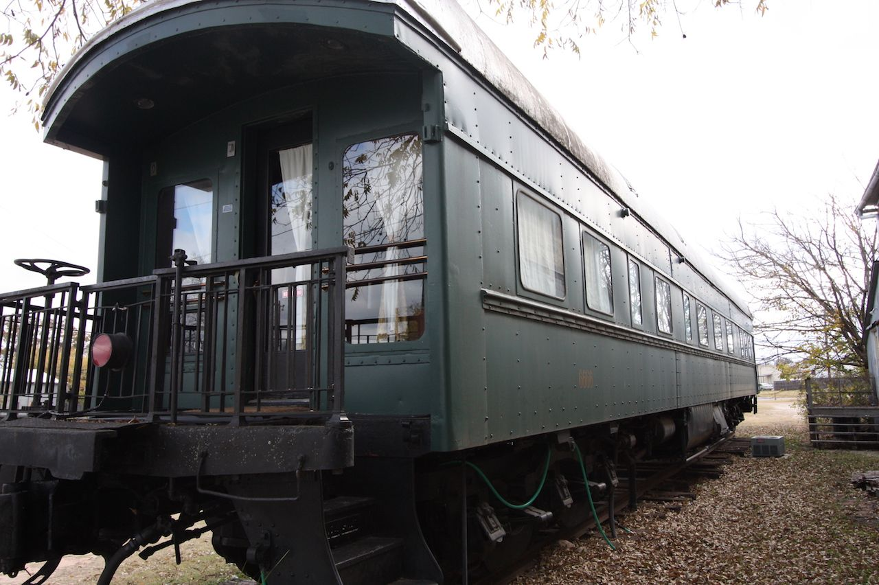 Antique green train turned Airbnb on its tracks