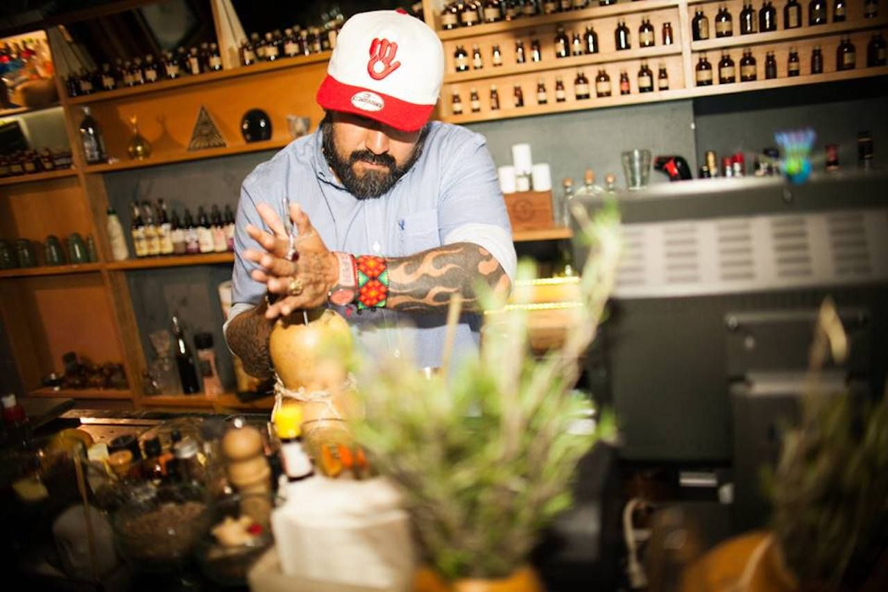 Bartender crafting a drink at Xaman in Mexico City