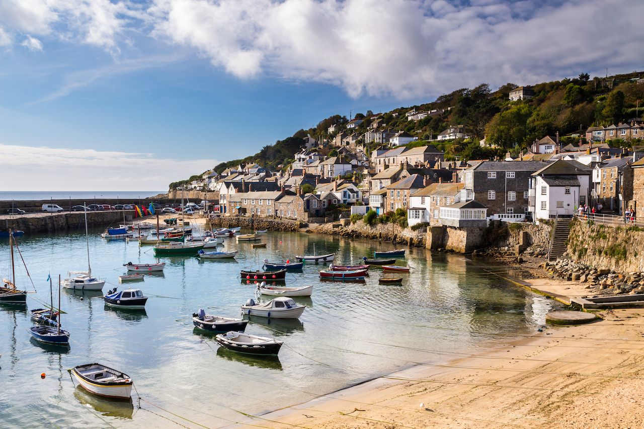 Beautiful summers day at Mousehole Harbor near Penzance Cornwall, England