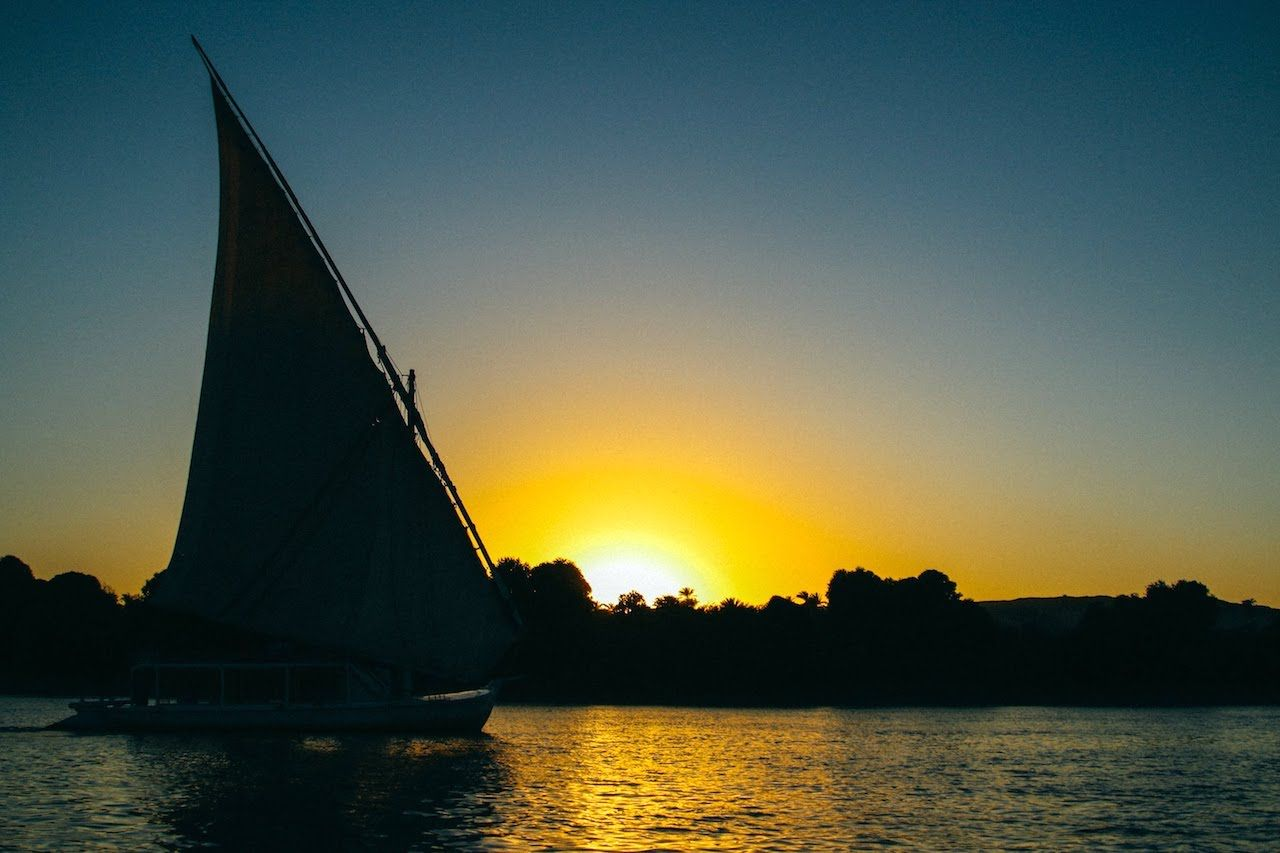 Boat on the water in Egypt at sundown