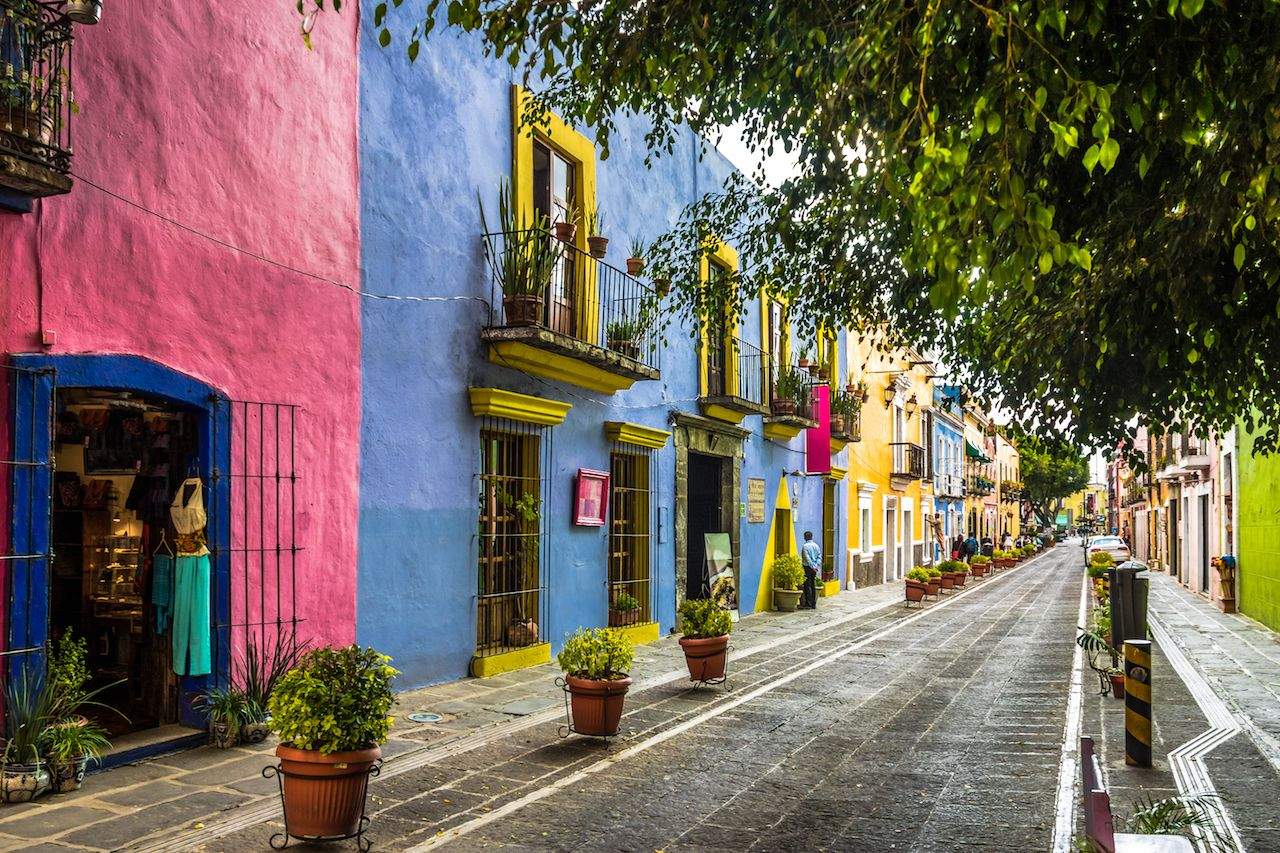 Colorful buildings lining a street in Puebla, Mexico