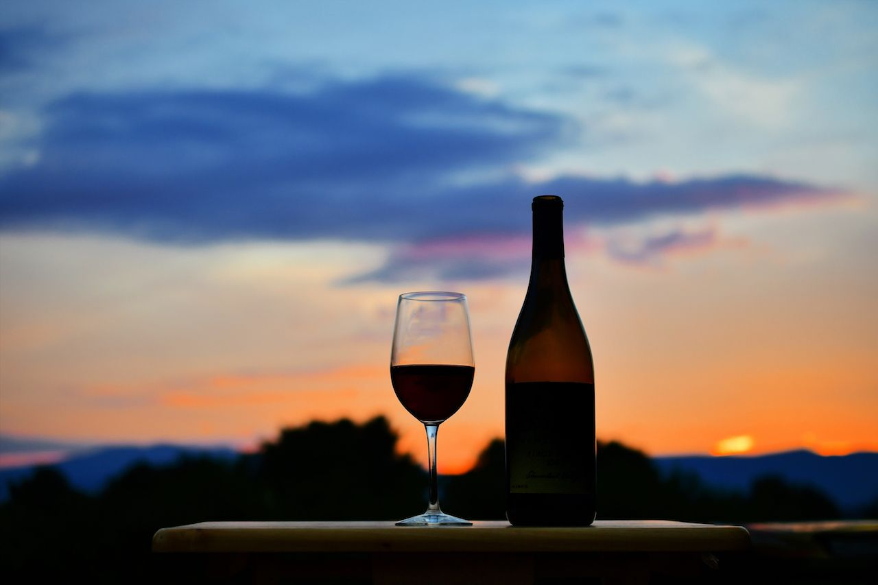 Enjoying a glass of red wine while watching the sunset over the mountains in the Shenandoah Valley of Virginia