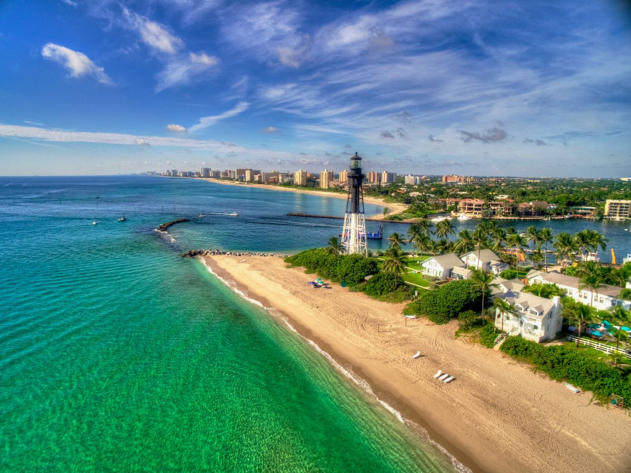 Fort Lauderdale lighthouse and emerald water on the coast