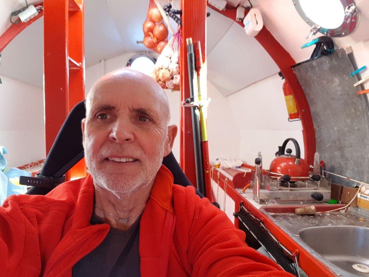 Jean-Jacques Savin inside of the barrel he'll cross the Atlantic in