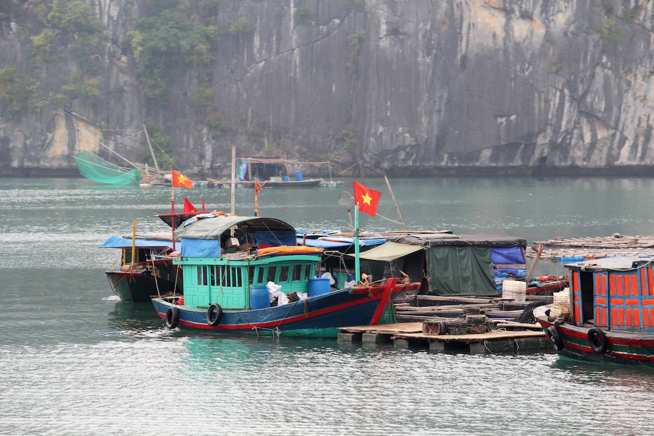Local fisherman's boats at Cat Ba Island in Ha Long Bay, Vietnam