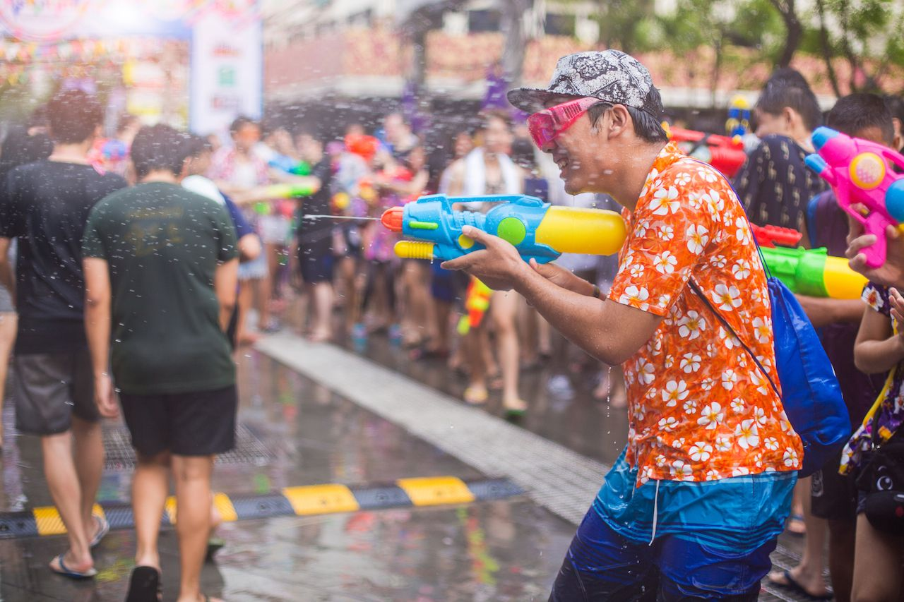 Man with water gun at Songkran Festival in Thailand