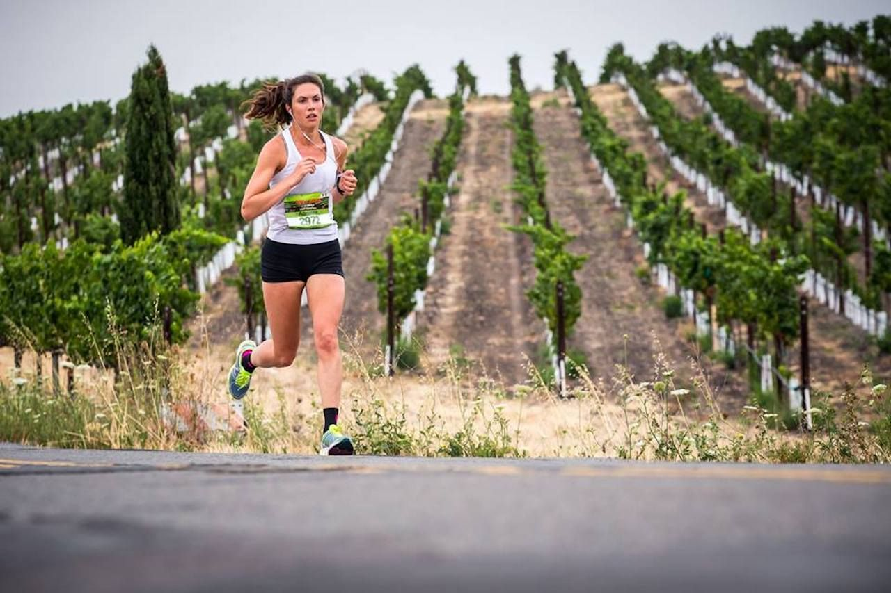 Napa to Sonoma Wine Country Half Marathon runner by vineyards