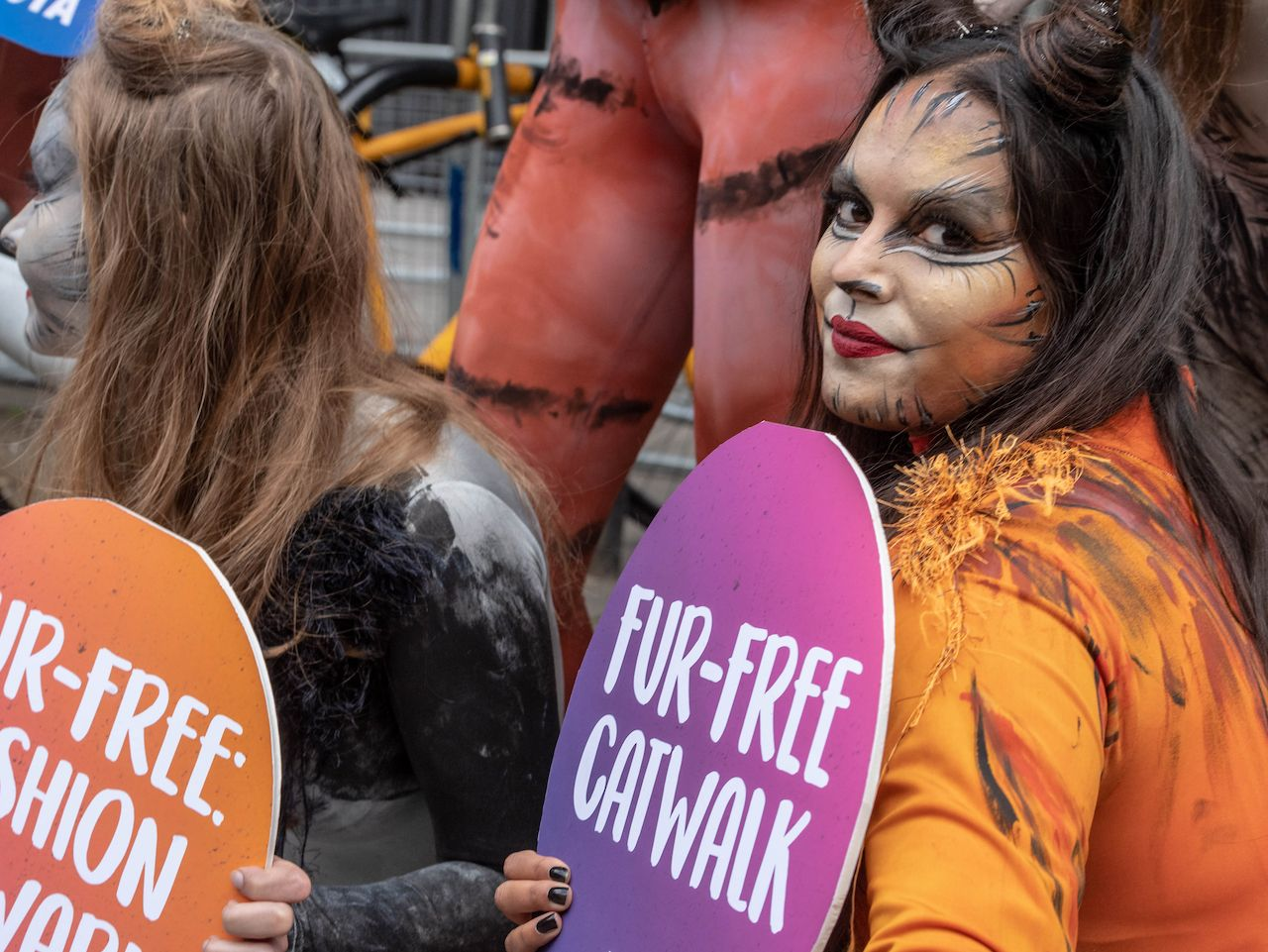 PETA demonstrators in cat outfits celebrate a No Fur fashion week in London