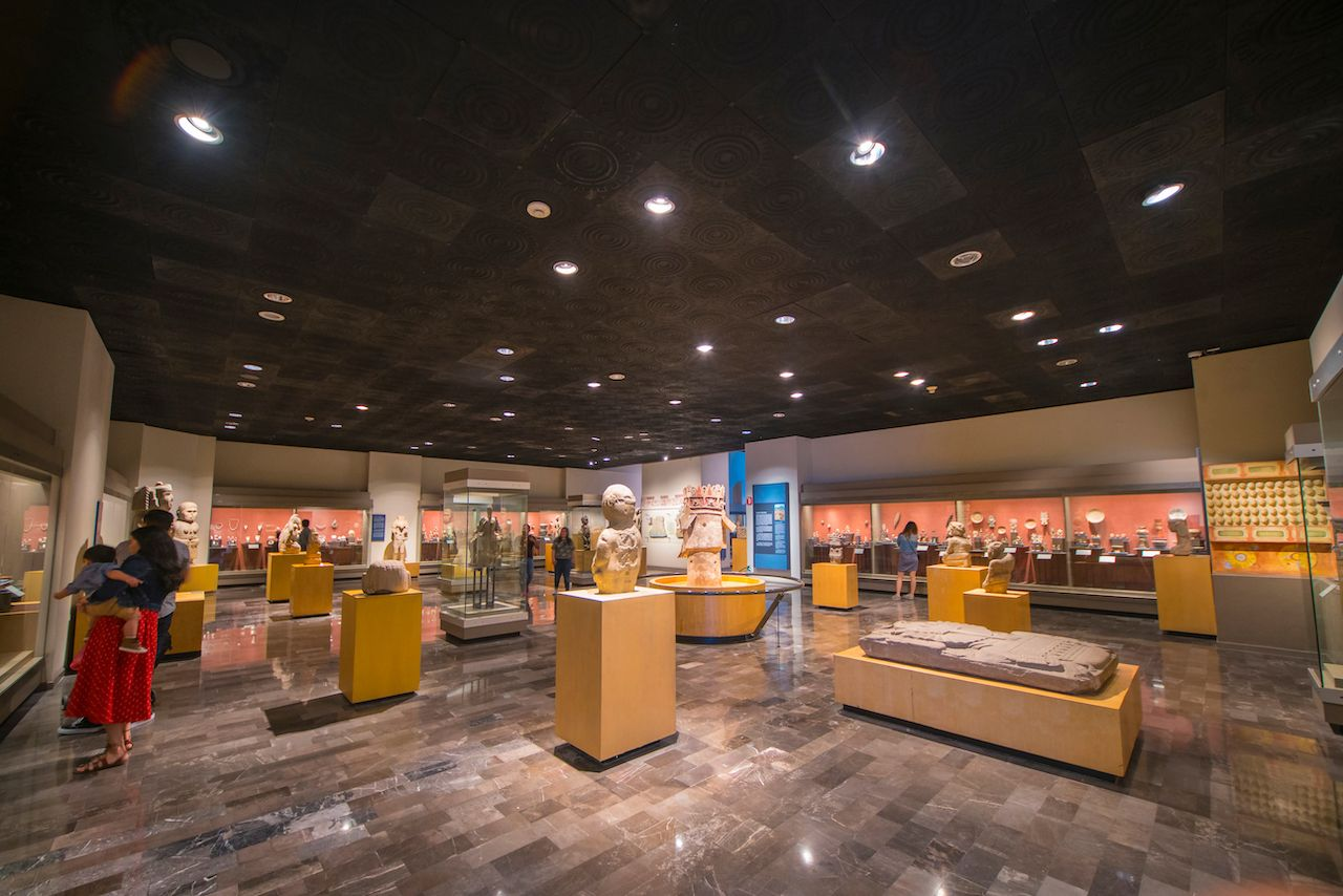 Panoramic view of an exhibition room in Nationa Museum of Anthropology in Mexico City