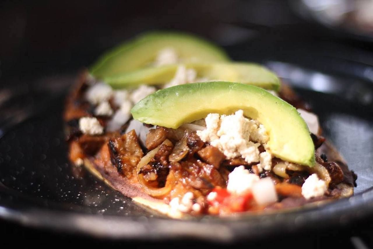 Tacos with meat, avocado, and cotija from a restaurant in Mexico City