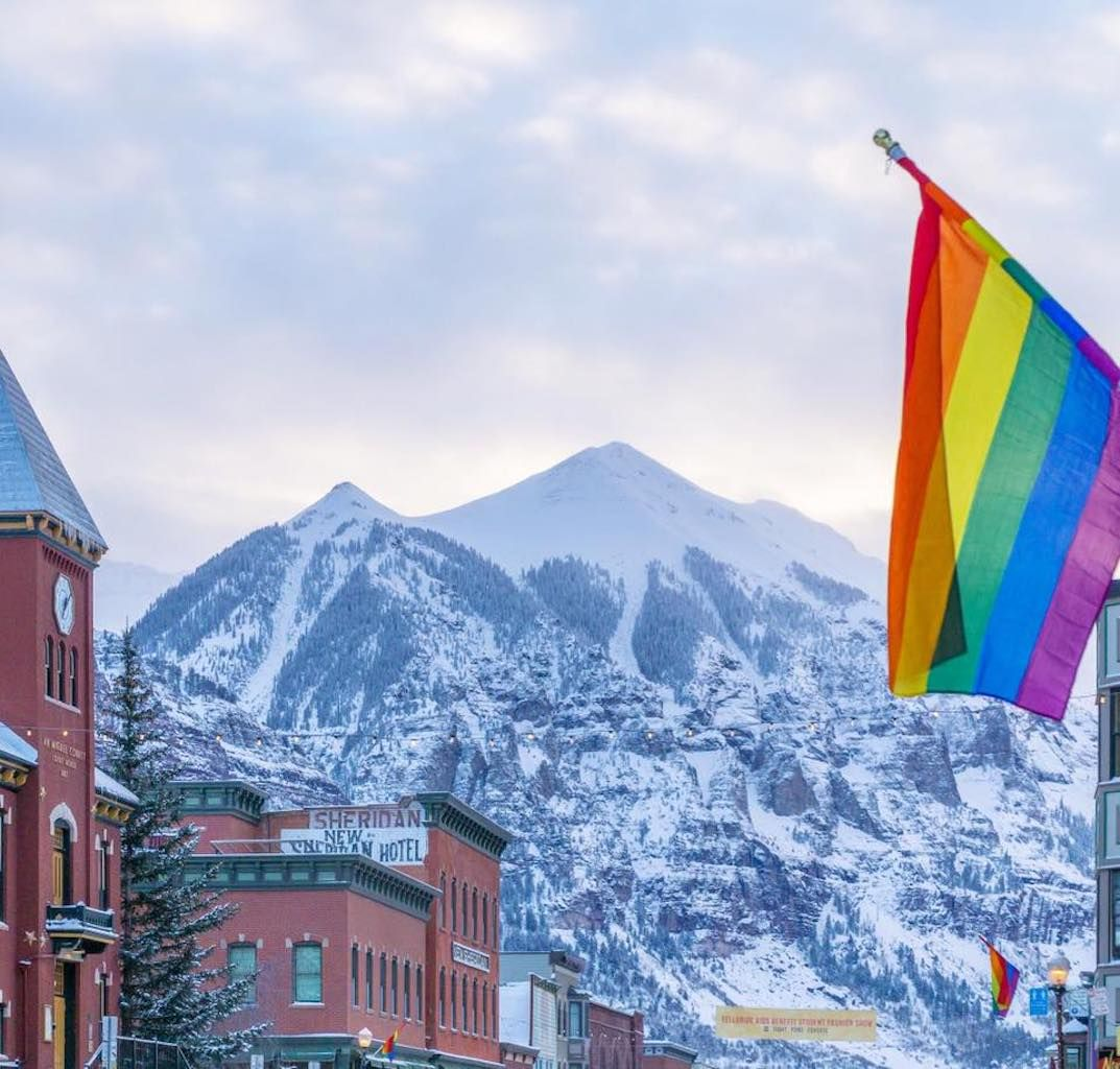 Telluride Gay Ski Week rainbow flag hanging in front of the mountain
