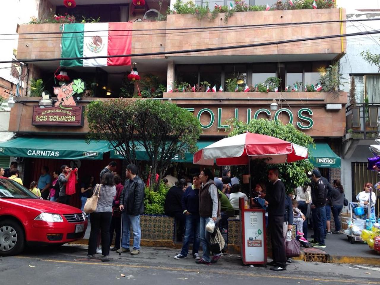 People standing outside Los Tolucos in Mexico City