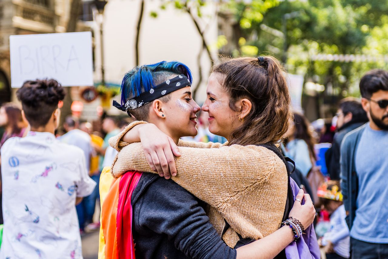 Two people embracing during Pride parade in Buenos Aires, Argentina