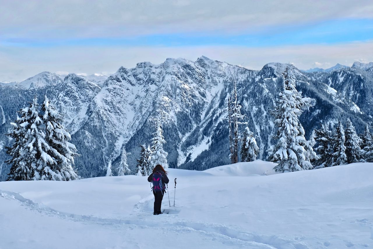 Woman snowshoeing in North Shore mountains near Vancouver