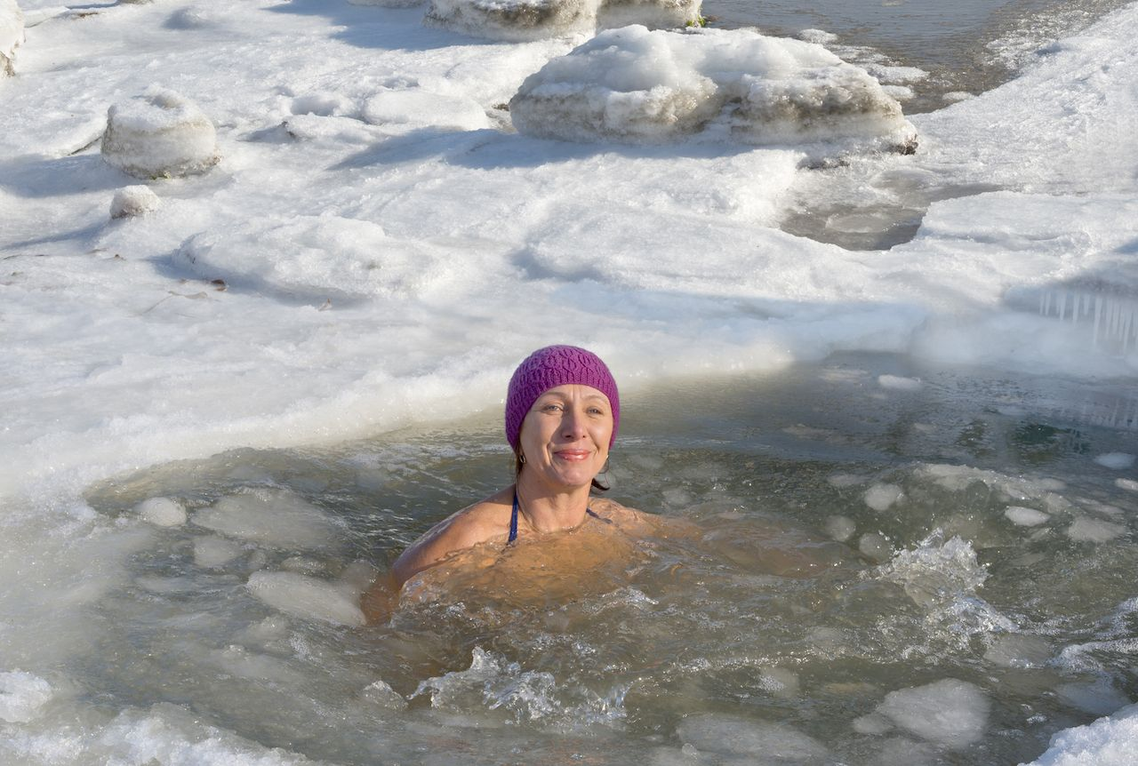 Woman swimming in ice water in Primorye region, Russia