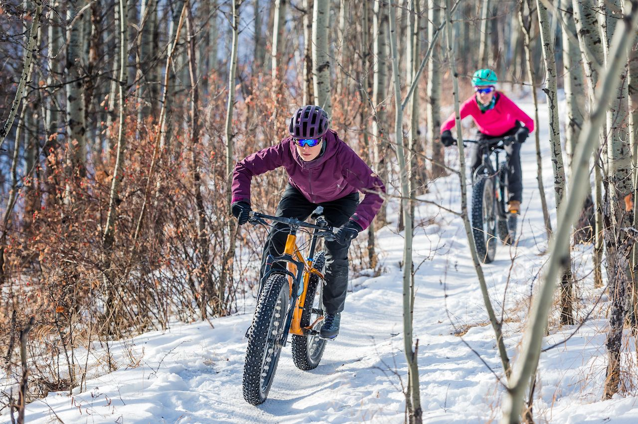 Women Mountain Biking on Fat Bikes in the winter