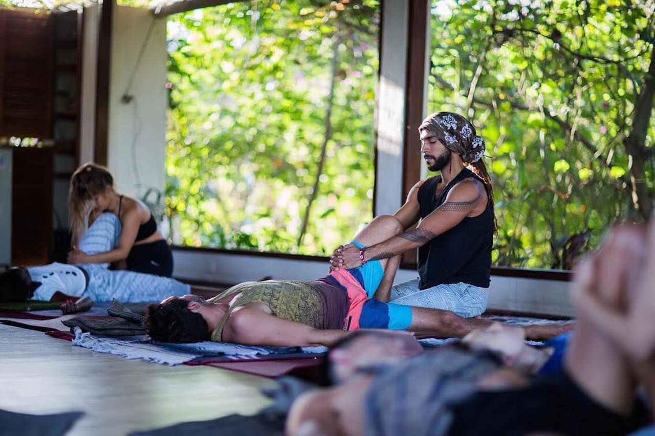 People practicing yoga at Yoga Barn in Bali, Indonesia