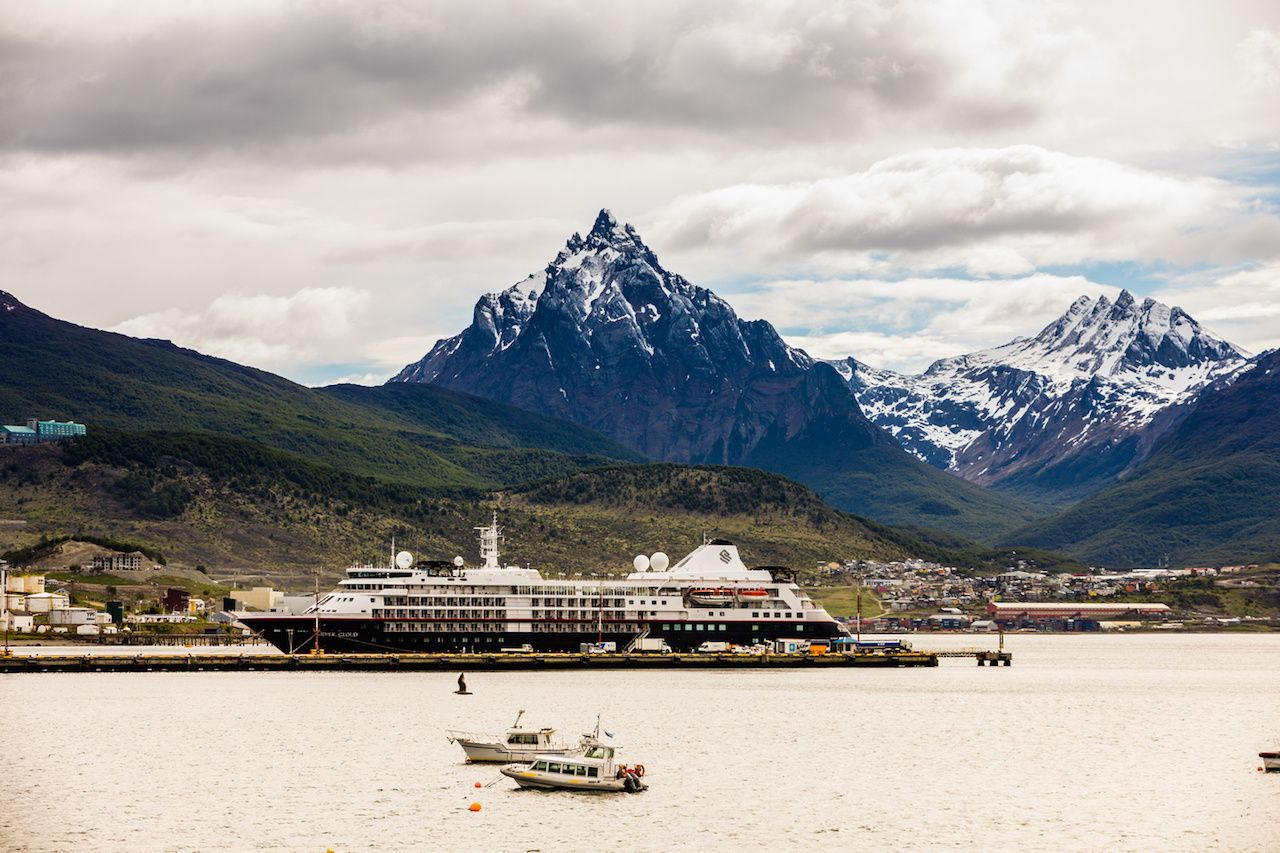 Antarctic cruise docked in front of mountains
