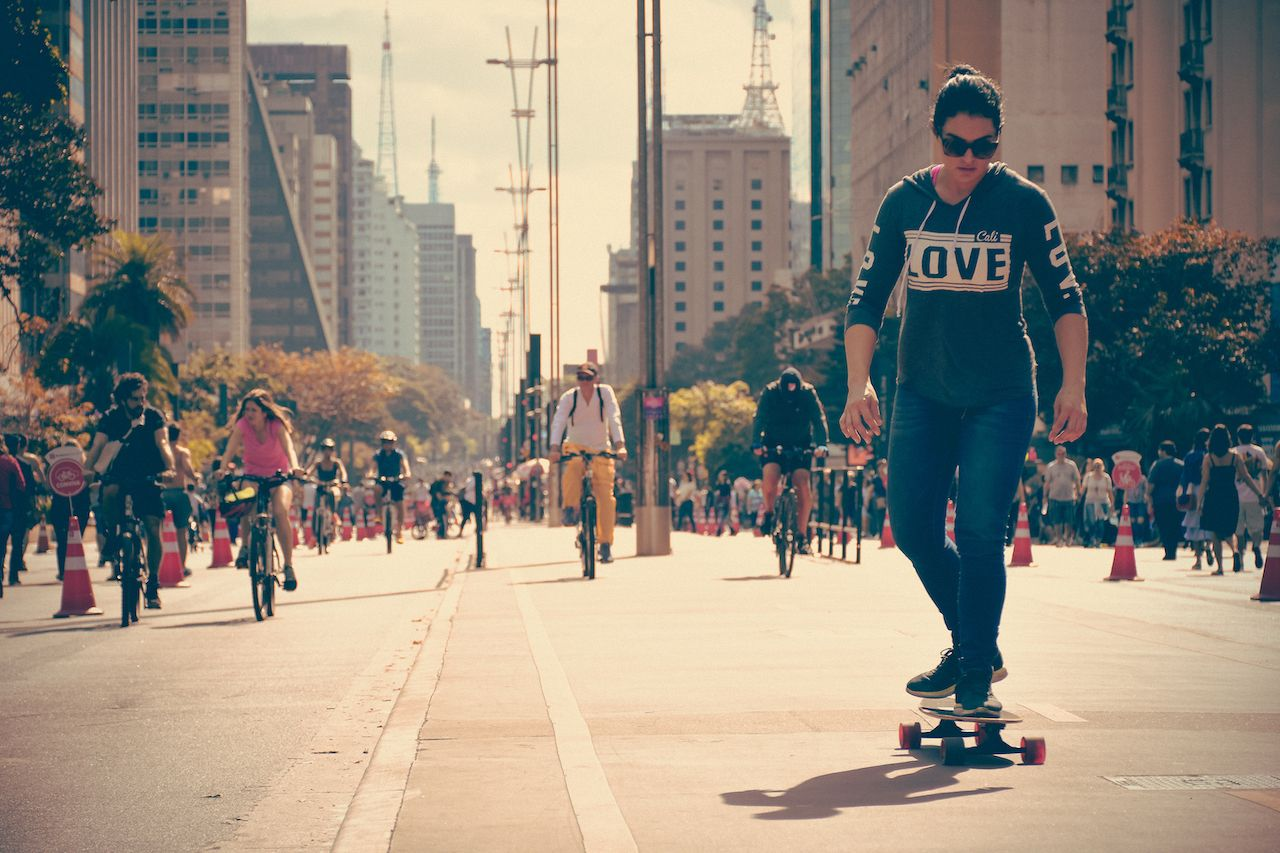 Avenida Paulista in Sao Paulo closed for leisure filled with cyclists, and skateboarders