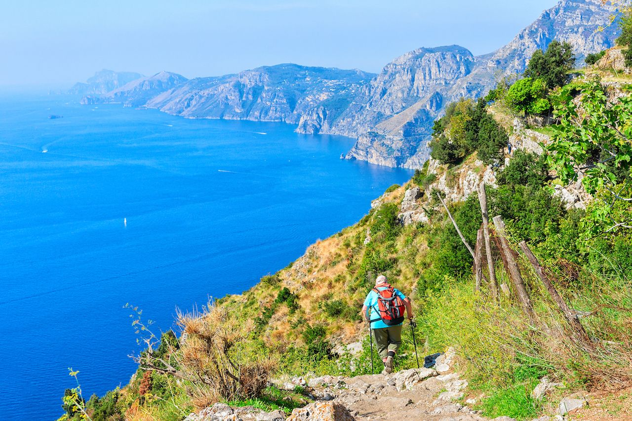 Backpacker with nordic walking at Path of Gods, Amalfi Coast, Italy