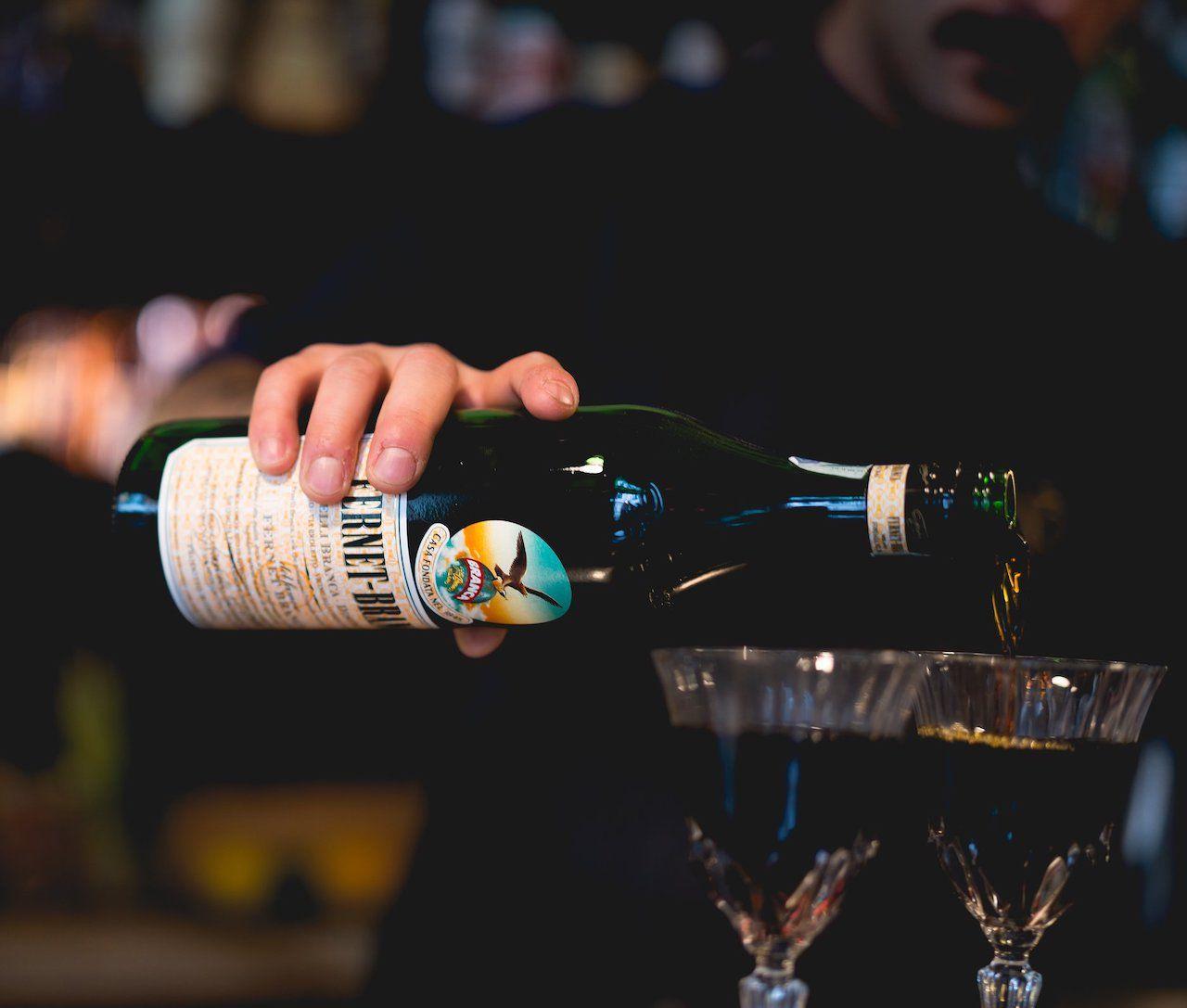 Bartender pouring Fernet