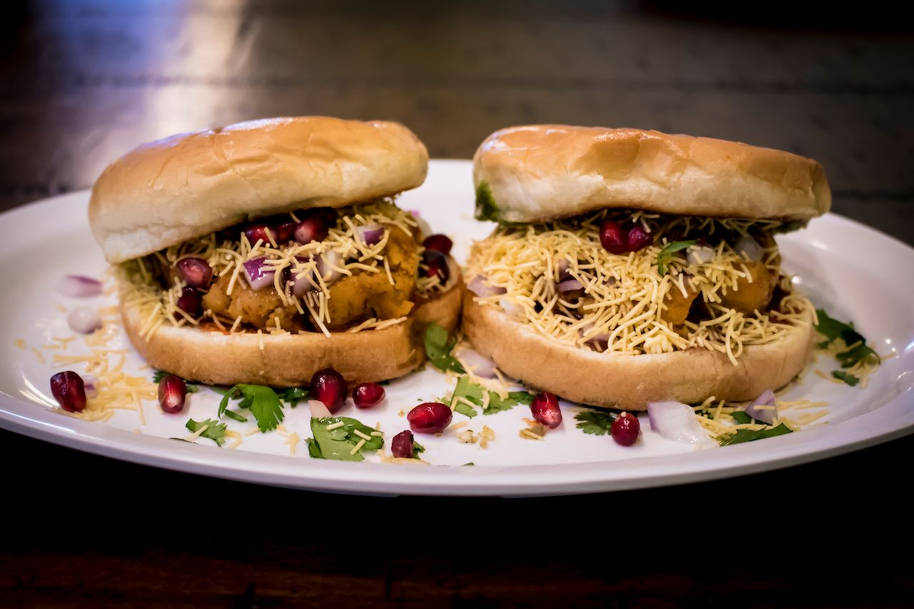Beautifully Plated Indian Food Dabeli with Pomegranate Seeds and Served Cilantro at Navratri