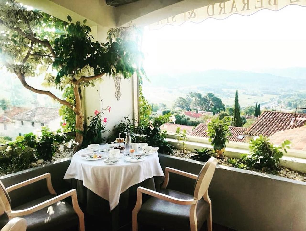 Breakfast table with a view and greenery in France