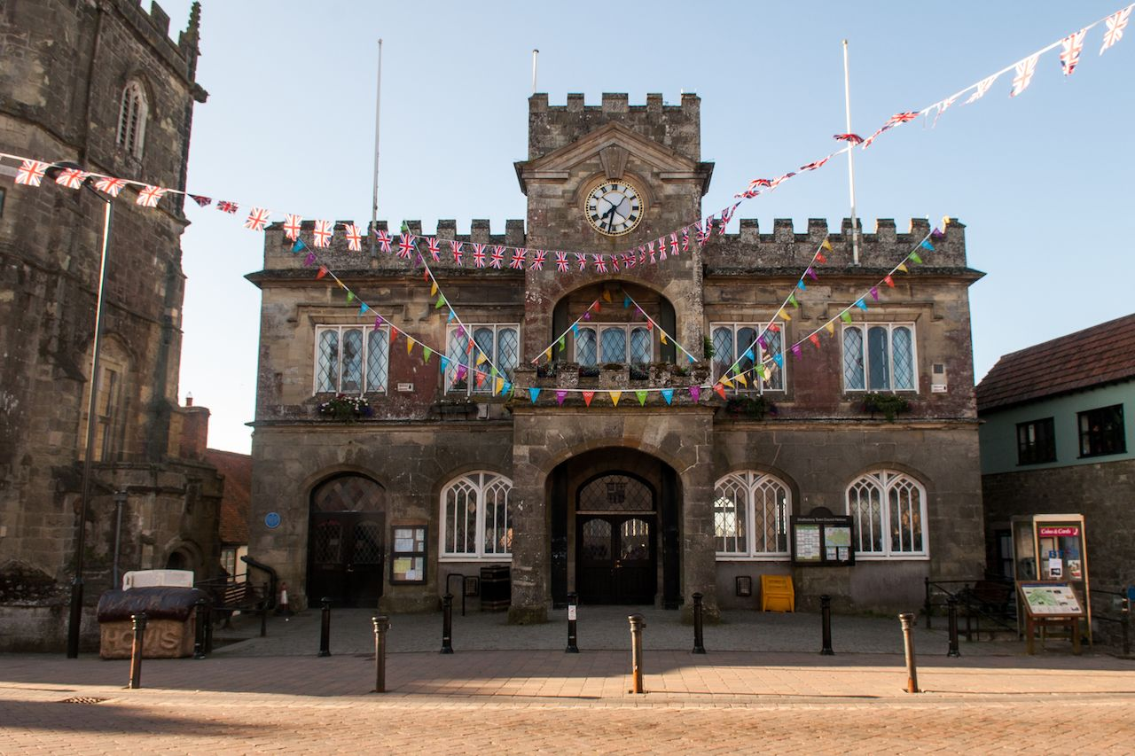 Bunting decorates the castellated stone town hall of Shaftesbury in Dorset during Queen Elizabeth's Jubilee celebrations