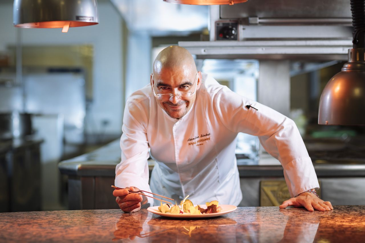Chef Alejandro Sanchez perfecting a dish at a Barcelo resort