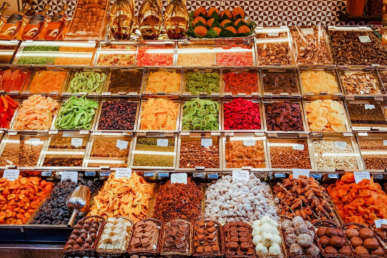 Counter with spices and dried fruit at Boqueria Market in Barcelona